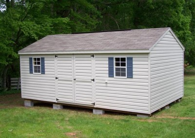 12 x 20 V-A-roof with silvermist siding and trim, driftwood shingles, slate blue shutters and a ridgevent