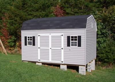 12 x 16 V-High Barn with flint siding, onyx black shingles, black shutters and white trim