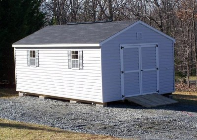 12 X 20 V-A-roof with gray siding, white trim, pacific blue shutters and onyx black shingles