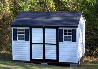 10 x 12 V-A-roof with white siding, black trim, black shingles and black shutters