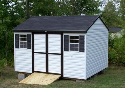 10 x 12 A-roof with white siding, black trim, black shingles and black shutters