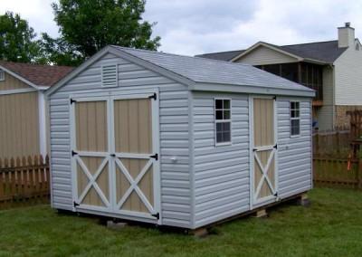 10 x 14 V-A-roof with gray siding, white trim around doors, and aspen gray shingles
