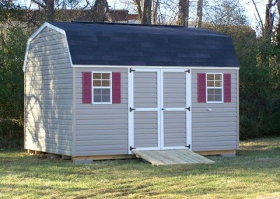 10 x 14 V-High Barn with clay siding, white trim, maroon shutters and onyx black shingles
