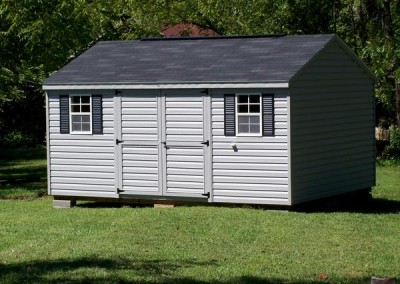 12 x 16 V-A-roof with flint siding and trim, black shingles and black shutters