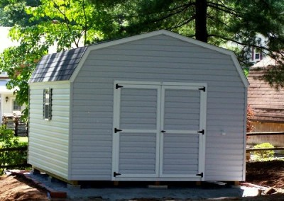 12 x 16 V-High Barn with gray siding, white trim, estate gray shingles and black shutters