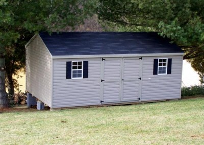 12 x 20 V-A-roof with clay siding and trim, onyx black shingles, and black shutters