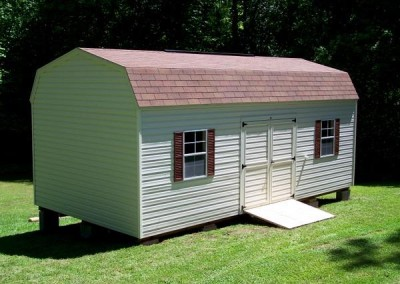 12 x 24 V-High Barn with ivory siding and trim, autumn brown shingles, redwood shutters, and 1' taller walls