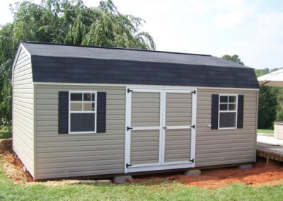 14 x 20 V-High Barn with clay siding, white trim, black shingles, black shutters and larger windows