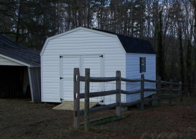 12 x 16 V-High Barn with white siding and trim, black shingles and shutters